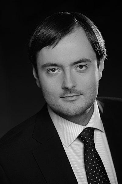 EY - Michał Rączy